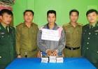 Bắt đối tượng người Lào vận chuyển 10 bánh heroin sang Việt Nam