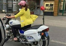 Bất ngờ danh tính cô gái mặc thường phục đi dép lê lái xe CSGT