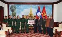Bộ Quốc phòng Việt Nam trao 50.000 USD ủng hộ Lào khắc phục sự cố vỡ đập thủy điện