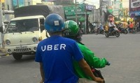 Thương vụ Grab thâu tóm Uber:  Chuyên gia pháp lý nói gì?