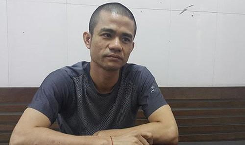 Đối tượng Lê Ngọc Sơn tại cơ quan Cảnh sát điều tra.