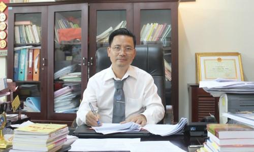 Ông Quản Văn Minh