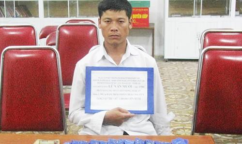Đối tượng Lữ Văn Mười cùng tang vật bị bắt giữ.